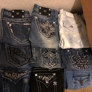 Misc pairs of size 27 Miss Me's (ask for pricing)